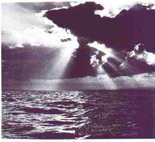 Picture of the sea with sun rays streaming on it.